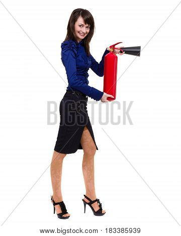 beautiful young businesswoman, using a fire extinguisher. standing full length isolated on white background