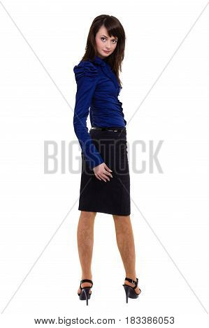 Full length portrait of businesswoman standing against white background while looking at camera