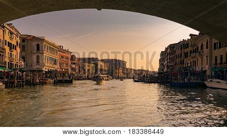 Grand canal at sunset seen from under the Rialto Bridge Venice Italy.