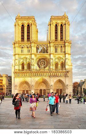 Paris, France - September 19, 2011: Walking people near Notre Dame de Paris in the evening