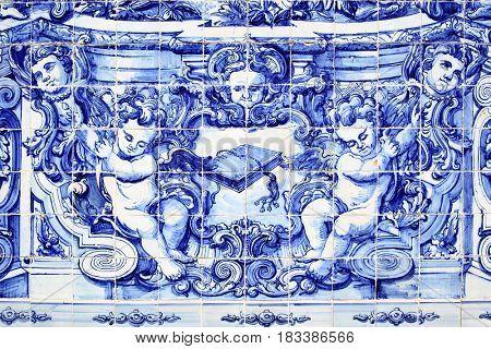 Porto, Portugal - May 13, 2012: Detail of traditional portuguese tilework azulejo on outer wall of the Capela Das Almas De Santa Catarina church in Porto