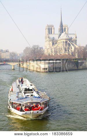 Paris, France - March 05, 2011: Tourist pleasure boat near Notre Dame de Paris