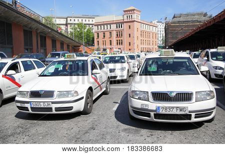 Madrid, Spain - May 10, 2012: Lots of white taxis near Atocha train station in Madrid