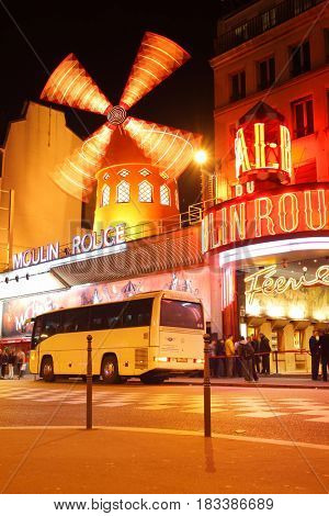 Paris, France - March 04, 2011: The Moulin Rouge cabaret at night in Paris, France