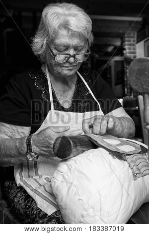 Burano Italy - September 21 2015: Burano is an island in the Venice lagoon known for the centuries-old craftsmanship needle lace of Burano.