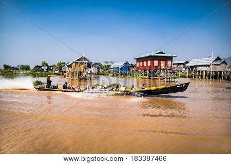 INLE , MYANMAR, MARCH 3, 2017: Transportation by boat in floating village Shan at Inle Lake on March 4, 2017, Myanmar. (Burma)