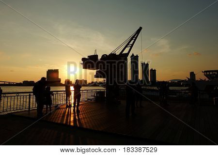 BANGKOK THAILAND - APRIL 15 2017: Sunset at Asiatique the riverfront Bangkok Thailand. Asiatique is the Bangkok night market opened in May 2012.