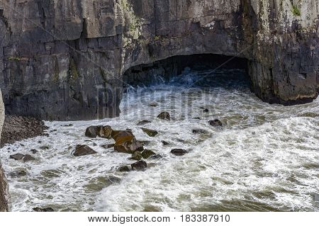 Cave being invaded by the sea in the stone of the Guarita in Torres city Rio Grande do Sul Brazil