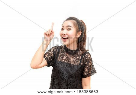 Portrait Of Asia Woman Smiling And Pointing Up, Isolated On White Background