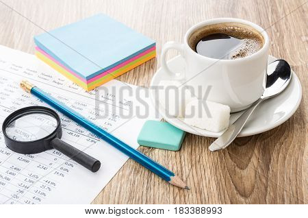 Financial Printout, Pencil, Eraser, Magnifying Glass, Coffee And Lumpy Sugar