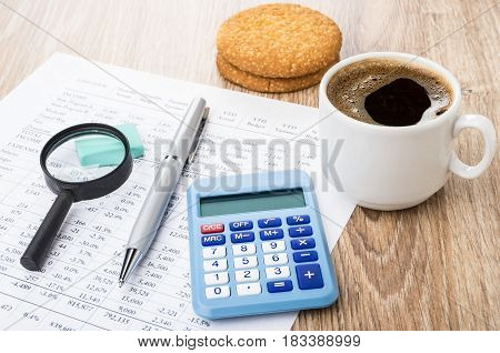 Financial Printout, Pen, Magnifying Glass, Calculator, Coffee And Shortbread