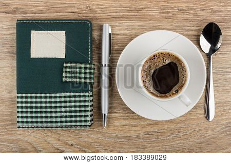 Notepad, Ballpoint Pen, Coffee And Spoon On Wooden Table