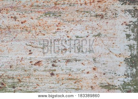 iron surface is covered with old paint, texture background