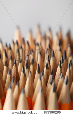 Yellow pencils on grey background, close up