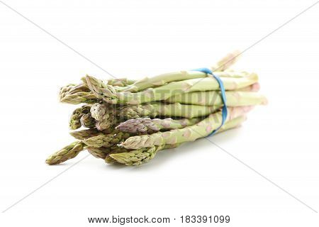 Heap Of Green Asparagus Isolated On A White Background