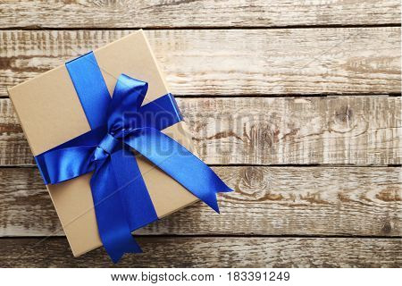 Gift Box With Ribbon On Grey Wooden Table