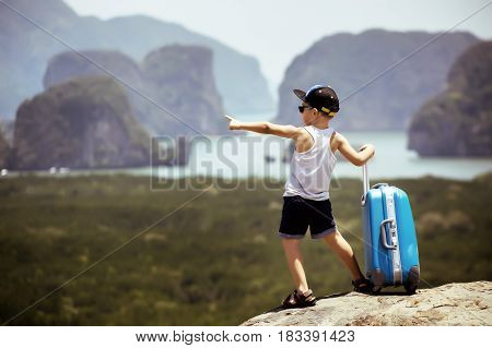 Travel concept with child and baggage case at travel destination.