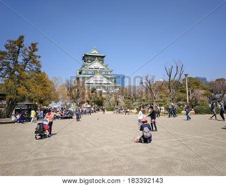 OSAKA CASTLE: OSAKA, JAPAN - APRIL 3, 2017: The Front View of Osaka Castle. This Castle is Very Famous Historic Tourist Attraction of Osaka Japan.