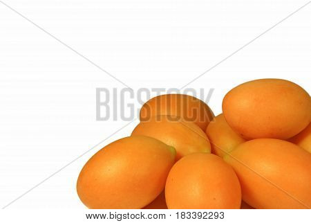 Closed up Heap of Vibrant Yellow Ripe Marian Plums Isolated on White Background