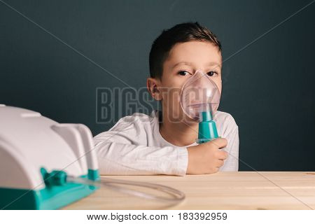 Beautiful Sick Boy Inhalation Therapy By The Mask Of Inhaler. Image Of A Cute Kid With Respiratory P