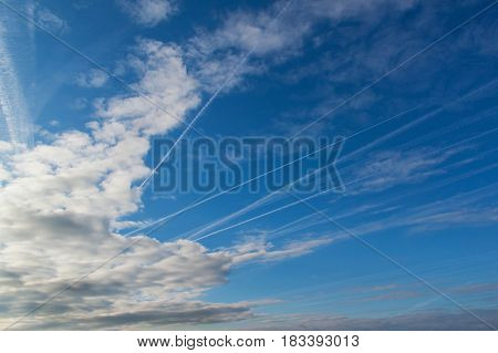 Morning sky and condensation traces of planes. Spring sky