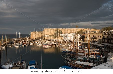 Kyrenia Cyprus - April 8. 2017: Harbourwith luxury travel yachts and boats at sunset at Kyrenia city harbor in Cyprus
