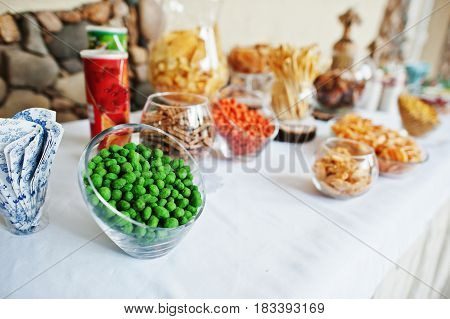 Table Catering With Peanuts And Snacks At Wedding Reception.