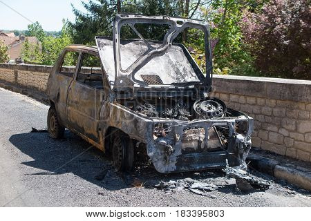 a car caught fire in the street