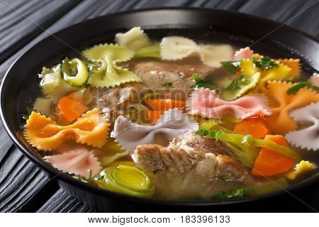 Delicious Soup With Meat, Multi-colored Farfalle Pasta And Vegetables Close-up. Horizontal