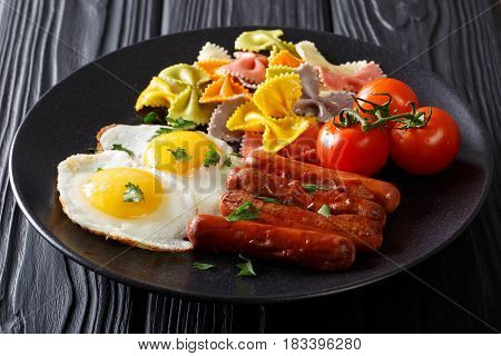Farfalle Pasta With Fried Eggs And Sausages Close-up. Horizontal