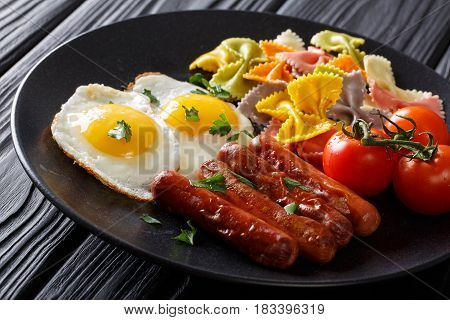 Fried Eggs With Sausages, Colored Farfalle Pasta And Tomatoes Closeup. Horizontal