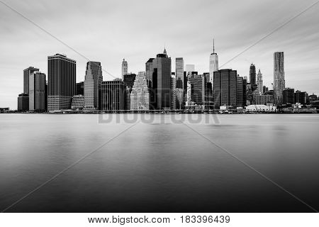 Manhattan downtown skyline in cloudy day, black and white colors, New-York, USA