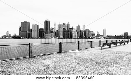 Manhattan skyline in cloudy day, black and white photography, view from Brooklyn Bridge Park, Pier 5, New-York City, USA