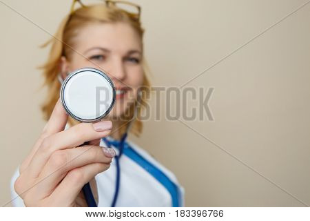 Girl in glasses with phonendoscope