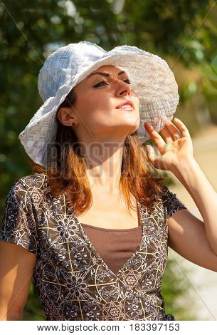 Portrait Of Young Smiling Beautiful Woman. Beautiful young fashion model posing outdoor. Summer outdoor portrait