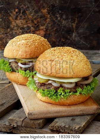 Veggie Burgers With A Chop Of Black Beans, Lettuce, Pickled Onions, Cucumber On A Brown Wooden Backg