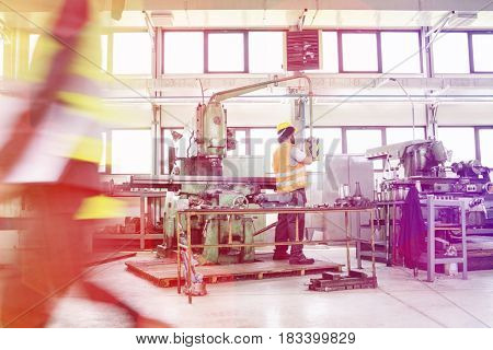 Manual worker operating machinery at metal industry