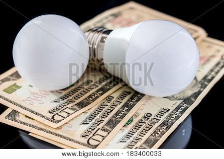 led bulb with usa money isolated on a white background
