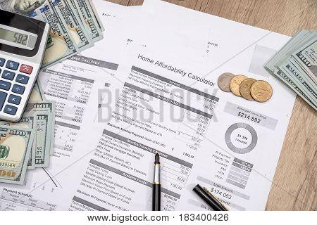 income statement with dollar cash and pen bank statement finance saving and investment concept.