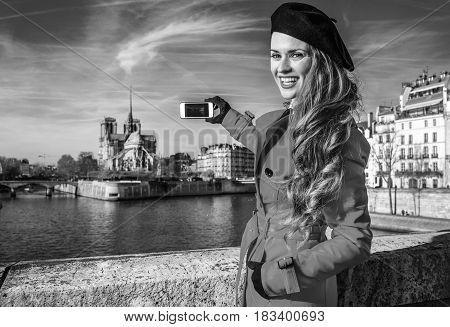 Traveller Woman In Paris Taking Photo With Smartphone