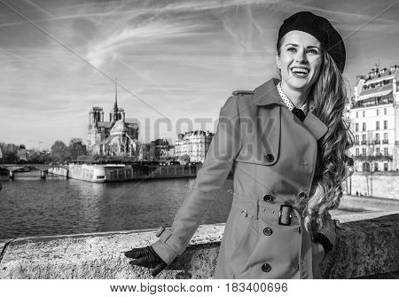Tourist Woman Lon Embankment In Paris Looking Into The Distance