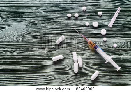 Design for International Day against Drug Abuse. The concept of No drugs or anti doping in sport or zero tolerance to drugs. No drugs concept drugs pills on a wooden background top view flat lay.