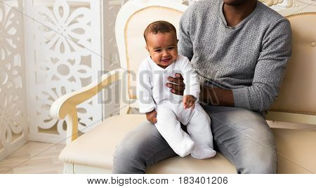 African American Father Playing With mixed race Baby Son.