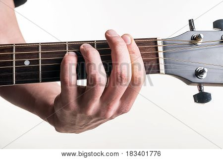 The Guitarist's Hand Clamps The Chord Fm On The Guitar, On A White Background. Horizontal Frame