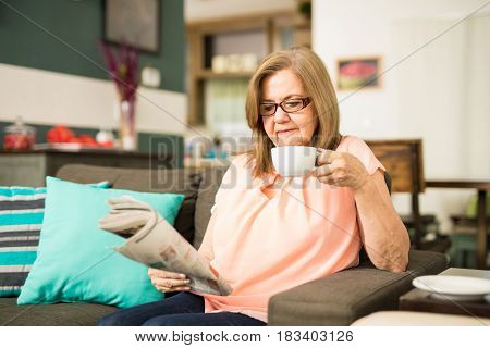 Grandmother Drinking Coffee While Reading