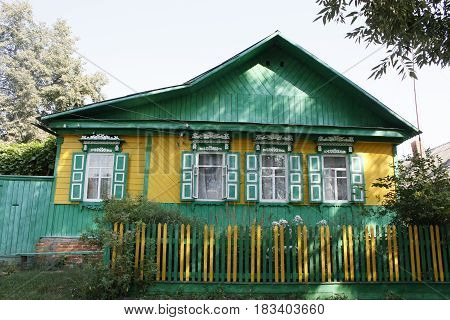 Traditional russian village house. Summer on the countryside.
