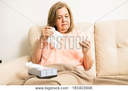 Elder Woman Sick With Flu And Fever