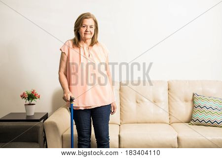 Senior Woman Holding Walking Stick For Support