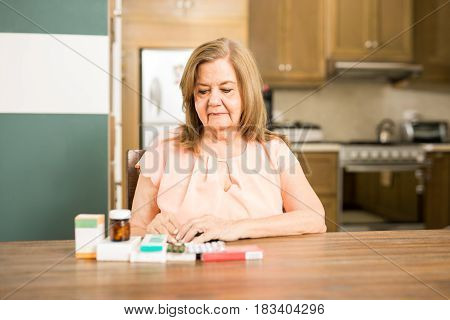 Senior Mature Woman Looking At Her Medicines