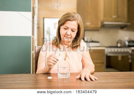 Senior Woman Taking An Effervescent Tablet